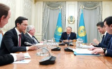 Meeting with Zhenis Kasymbek, Investment and Development Minister, Richard Evans, Board member of Samruk-Kazyna JSC and Peter Foster, President of Air Astana